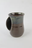 Clay in Motion Handwarmer Mug