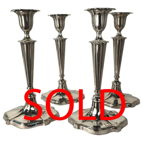 Set of Four Neoclassical Style Hall Marked Silver Candlesticks