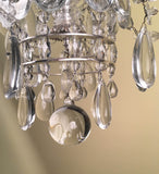 French Silvered Bronze and Cut Crystal Twelve-Light Chandelier