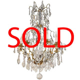 Louis XV Style Gilt Bronze and Crystal Eight-Light Chandelier