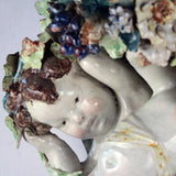 Majolica Cherubs supporting Wall Bracket