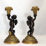 Pair of French Louis XV Style Candlesticks, Modelled as Cherubs with Baskets