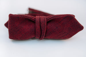 "A two-toned herringbone linen bow tie with red and black hues on this mid-weight bow tie.   Imported from Ireland.  100% Linen  Height: 1.75"": x Width: 5.5"" x Knot Size: .75"" (Approx.)  Dry Clean Only"