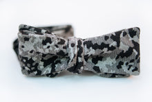 "A camouflage cotton bow tie with hues of black and variations of light and dark greys on this Japanese lightweight cotton bow tie.  Made In Japan. 100% Cotton  Height: 3"" x Width: 4.5""   Knot Size: .75""  (Approx.)   Dry Clean Only"