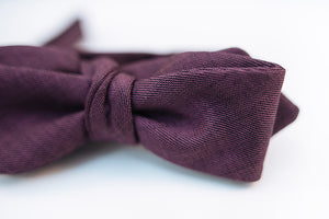 "A lustrous 100% virgin wool bow tie with hues of violet and a very light hint of black wool with this two-tone butterfly bow tie. This bow tie is reserved for those who want to distinguish themselves apart from the average wool bow ties and elevate their wardrobe.  100% Virgin Wool. Imported from Italy.  Height: 1.75"": x Width: 5.5"" x Knot Size: .75"" (Approx.)  Dry Clean Only"