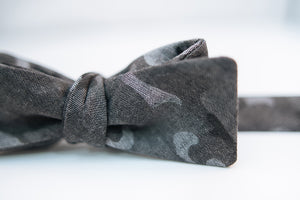 "A black & grey Camouflage Cotton Bow Tie.  Height: 3"" x Width: 4.5""   Knot Size: .75""  (Approx.)  Dry Clean Only"