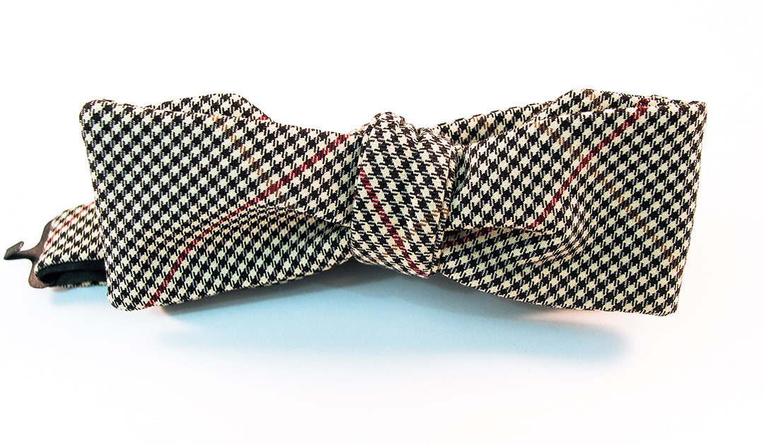 "A two-toned windowpane check bow tie with colors of black, red, and beige in this lightweight twill bow tie.   Height: 1.75"" x Width: 5"