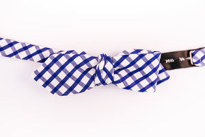 An Italian Cotton Blue & White Gingham Bow Tie With A Slim Diamond Tip Design.