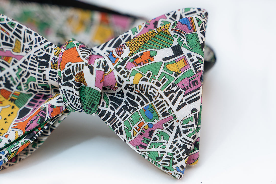 Enjoy an artist's interpretation of what London looks like from a bird side view. Abstract and playful is what you will get from this design.  You will get a full range of colors from the green and yellow fields to the blue body of waters. It even has some pastel pinks and orange abstract from the building designs.   No bow tie is guaranteed on pattern placement as each bow tie will vary slightly.   Height: 3