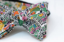 "Enjoy an artist's interpretation of what London looks like from a bird side view. Abstract and playful is what you will get from this design.  You will get a full range of colors from the green and yellow fields to the blue body of waters. It even has some pastel pinks and orange abstract from the building designs.   No bow tie is guaranteed on pattern placement as each bow tie will vary slightly.   Height: 3"" x Width: 4.25"" x Knot Size: .75  (Approx.)  Dry Clean Only"