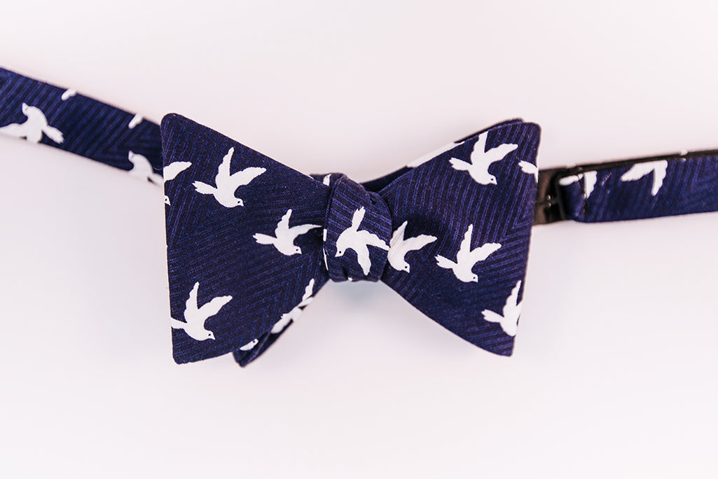 A Navy & White Cotton Dobby Jacquard Bow Tie With Dove Printed Pattern On This Butterfly Design.