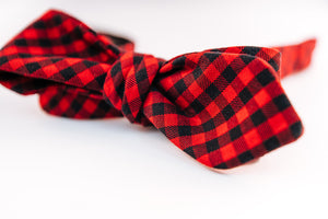 A red & black cotton Shepard's check bow tie with a slim diamond tip design.