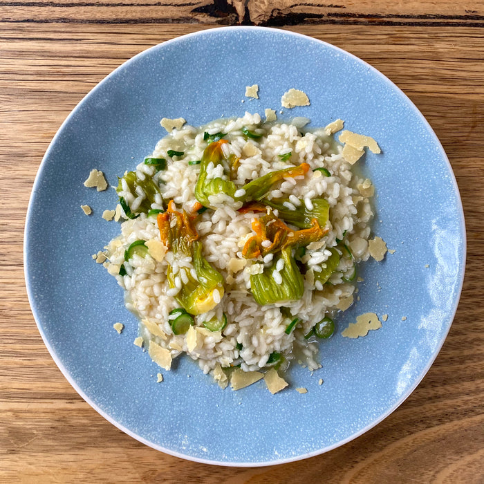 Summer risotto with baby zucchini flowers 🌻