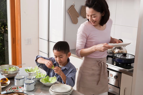 mom and son in kitchen preparing food