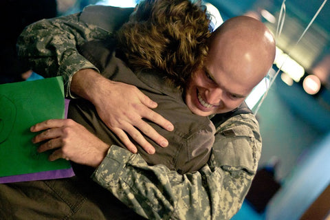mother and son hugging military