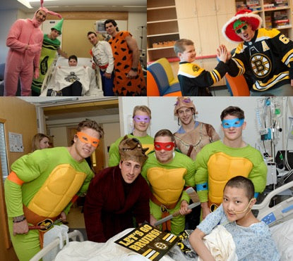 Bruins team dressed as Teenage Mutant Ninja Turtles at Children's Hospital