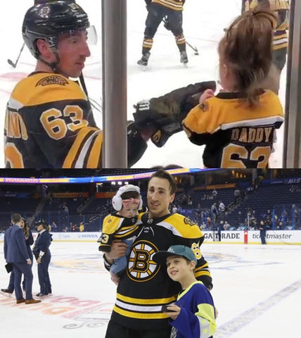 Brad Marchand with step son and daughter at game
