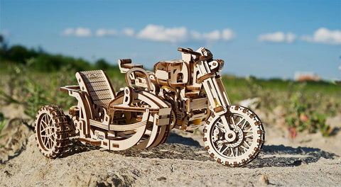 Scrambler motorcycle with side car model kit on dirt road