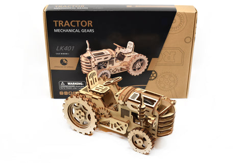 Completed tractor model infront of tractor building kit