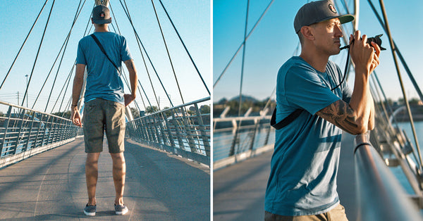 Founder of Heights, standing on bridge wearing blue signature tall t-shirt