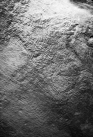Markings on the stone wall of a cave.