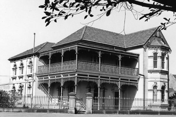 Black & white photograph of an ornate Victorian-era two-storey building.