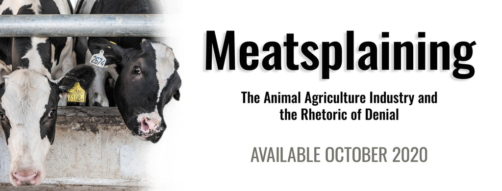 Image from Meatsplaining book cover, featuring faces of black and white cows in a feedling lot