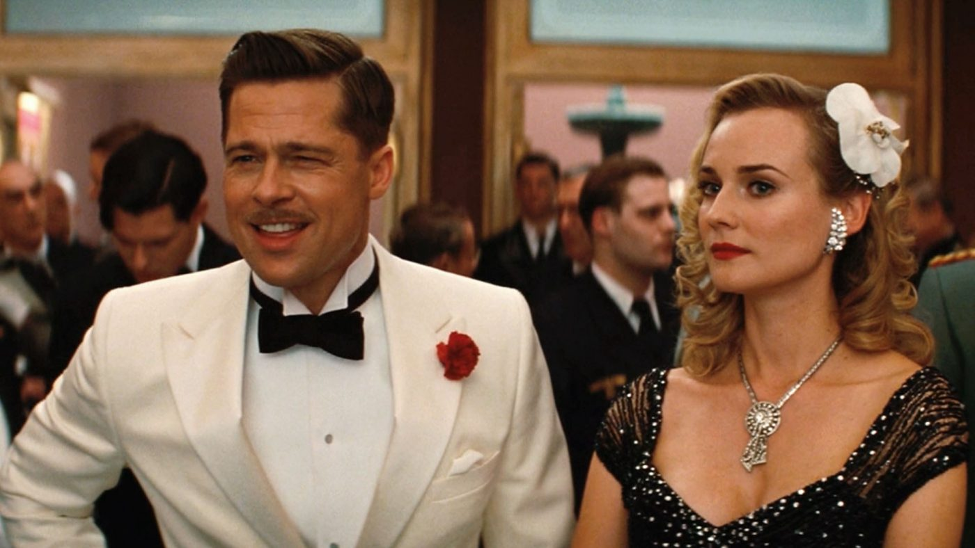 Brad Pitt is wearing a wingtip collar for his white tuxedo in Inglorious Basterds.