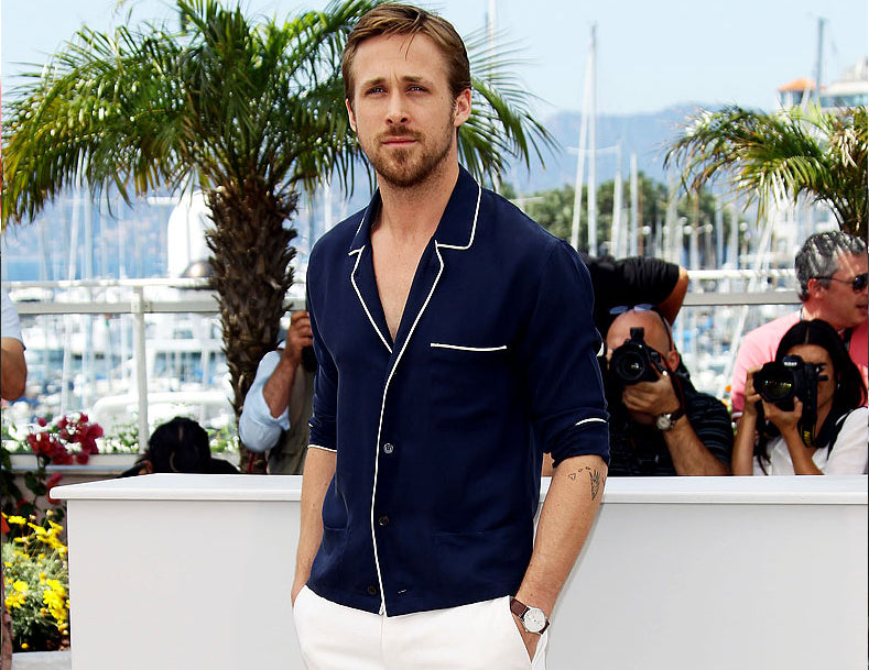Ryan Gosling combines his Cuban style shirt with white trousers in Cannes Film Festival.
