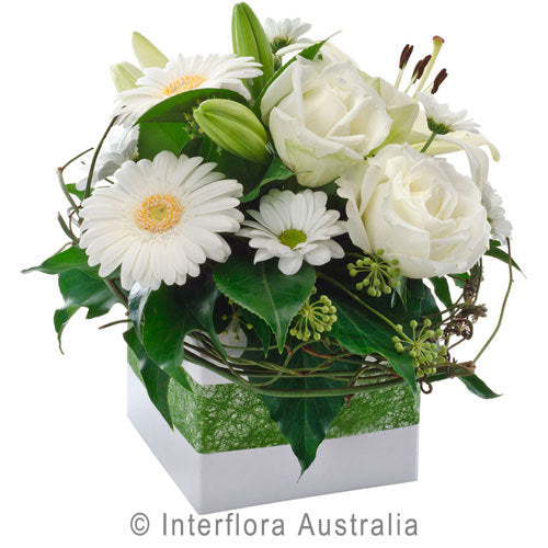 white flower box arrangement roses gerberas lilies