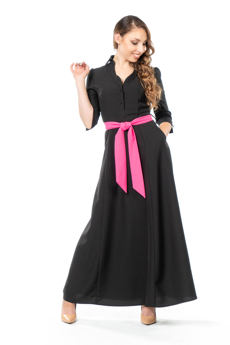 Front view of petite maxi dress in black with pink sash