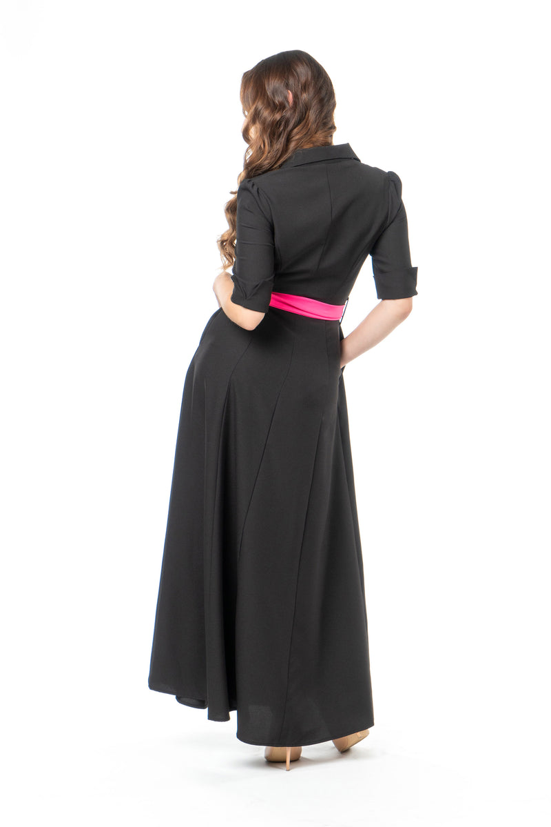 Back view of petite maxi dress in black with pink sash