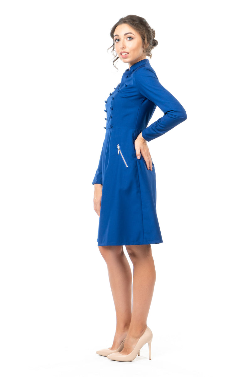 Side view of a petite military-style inspired dress in cobalt blue.