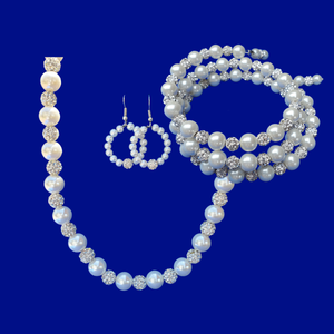 A handmade pearl and crystal necklace accompanied by an expandable, multi-layer, wrap bracelet and a pair of hoop earrings
