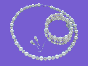 A handmade pearl and crystal necklace accompanied by an expandable multi-layer wrap bracelet and a pair of crystal drop earrings.