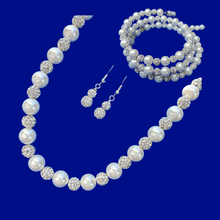 Load image into Gallery viewer, A handmade pearl and crystal necklace accompanied by an expandable multi-layer wrap bracelet and a pair of crystal drop earrings.