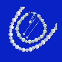 Load image into Gallery viewer, handmade pearl and crystal necklace accompanied by a matching bracelet and a pair of crystal drop earrings