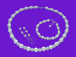 A handmade pearl and crystal necklace accompanied by a matching bracelet and a pair of crystal drop earrings. silver and ivory or silver and custom color