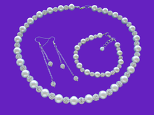 Load image into Gallery viewer, A handmade pearl and crystal necklace accompanied by a matching bracelet and crystal drop earring jewelry set, silver and ivory or silver and custom color