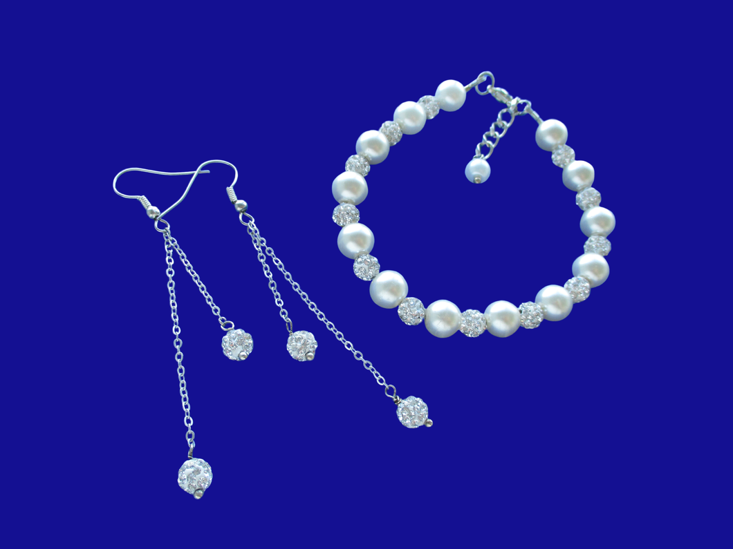 A handmade pearl and crystal bracelet accompanied by a pair of multi-strand drop earrings.