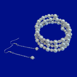 A handmade pearl and crystal expandable, multi-layer, wrap bracelet accompanied by a pair of crystal drop earrings.