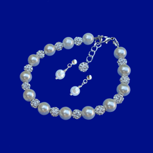 Load image into Gallery viewer, handmade pearl and crystal bracelet accompanied by a pair of stud earrings