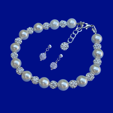 Load image into Gallery viewer, handmade pearl and crystal bracelet accompanied by a pair of crystal stud earrings, ivory and silver or silver and custom color