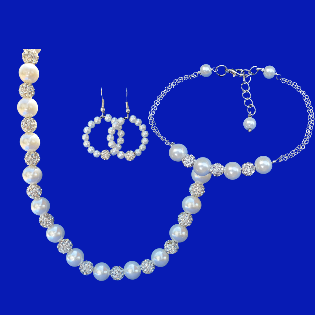 handmade pearl and crystal necklace accompanied by a bar bracelet and a pair of hoop drop earrings