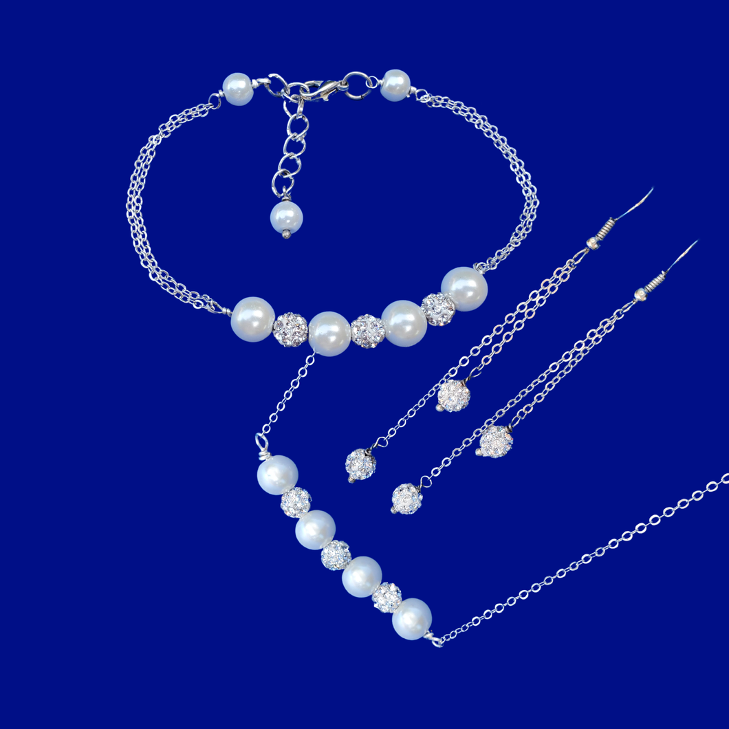 handmade pearl and crystal bar necklace accompanied by a matching bracelet and a pair of crystal multi-strand drop earrings