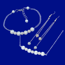 Load image into Gallery viewer, A handmade crystal and pearl necklace accompanied by a matching bracelet and a pair of drop earrings. This elegant jewelry set will make gorgeous bridal gifts.