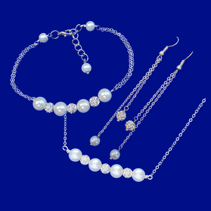 A handmade crystal and pearl necklace accompanied by a matching bracelet and a pair of drop earrings. This elegant jewelry set will make gorgeous bridal gifts.