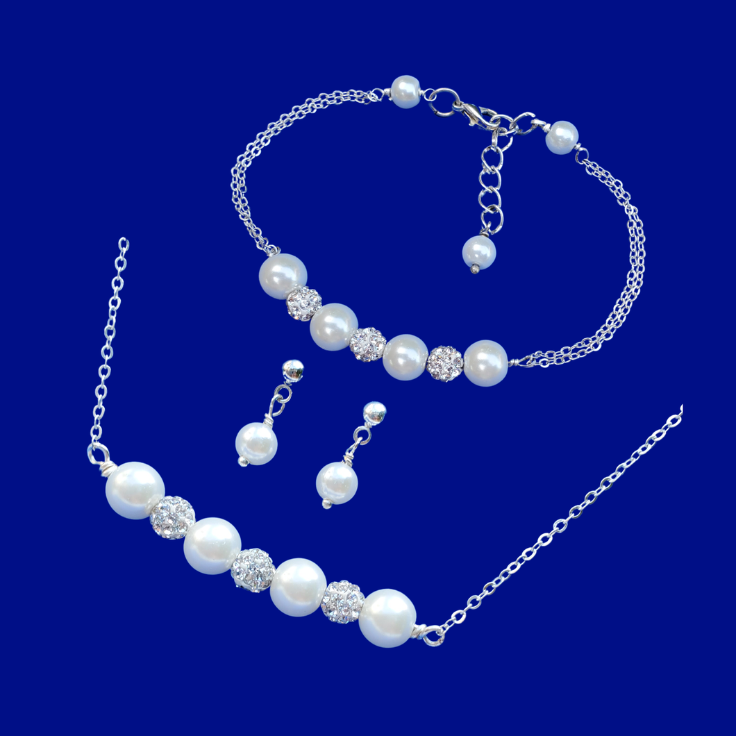 handmade pearl and crystal bar necklace accompanied by a matching bracelet and a pair of pearl stud earrings