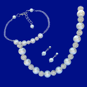 handmade crystal and pearl necklace accompanied by a bar bracelet and a pair of pearl stud earrings