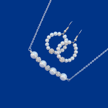 Load image into Gallery viewer, handmade pearl and crystal bar necklace accompanied by a pair of hoop earrings